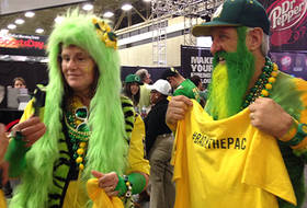 Oregon fans show off their creative hairstyles at Playoff Fan Central