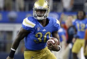 UCLA linebacker Myles Jack spins for a score at Washington