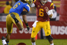 Eric Kendricks one-hands a key interception for UCLA against USC