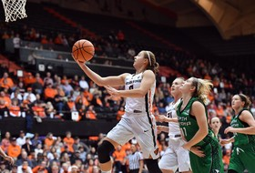 Michelle Smith Feature: Women's basketball teams gain in tough losses