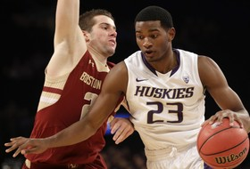 Wilcox's 23 Points, Key Free Throws Late Send UW Past Hartford