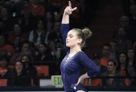 Bruins Shine on Beam to Beat Beavers, 197.250-196.825