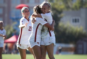 Hocking's Record Four Goals Lead Trojans Past Titans in NCAA Opener