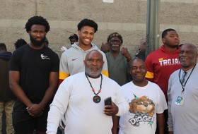Football Players Give Back On Their Off Day