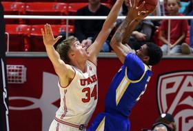 Johnson's Double-Double Leads Utah Past Tulsa, 69-64