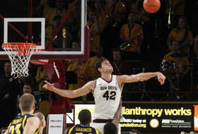 BLOCK-CHYNSKI! Holds Off No. 25 Marquette, 79-77