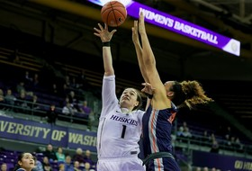 Johnson's Double-Double Leads Huskies Past Cal State Fullerton, 83-74